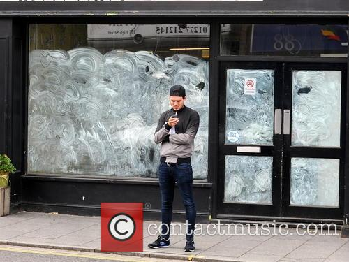 Charlie Sims stands outside his shop in Brentwood