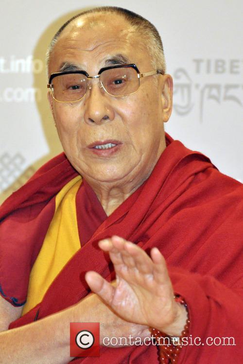 The Dalai Lama attends a press conference in...