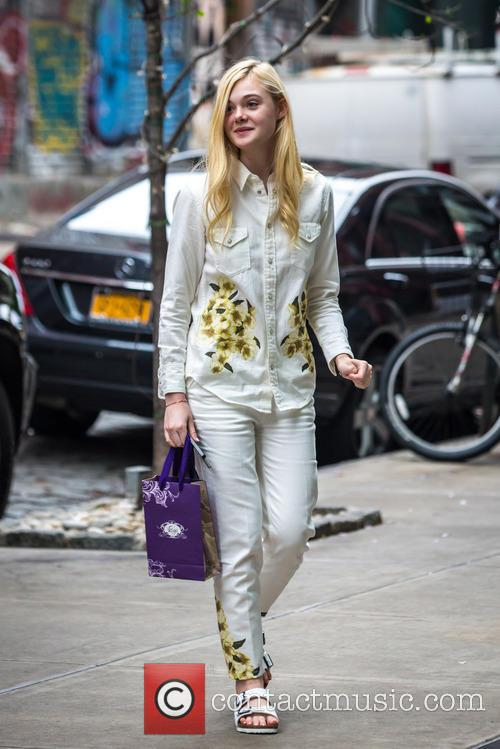 Elle Fanning returns to her hotel