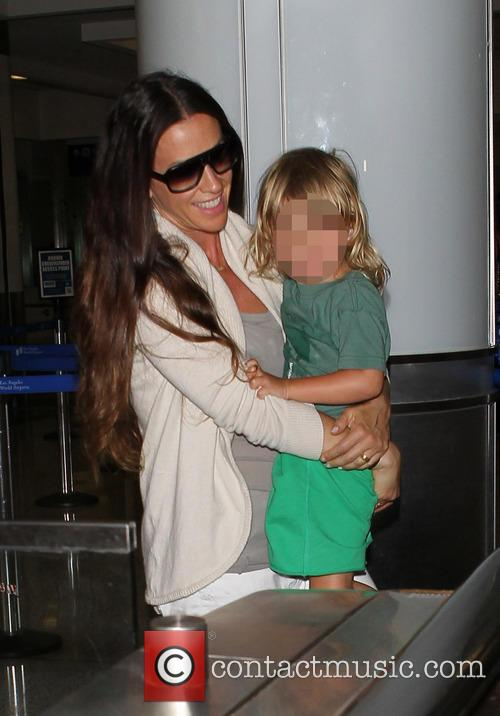 Alanis Morissette and family at LAX