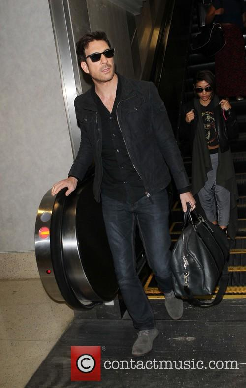 Dylan McDermott arriving at Los Angeles International (LAX)...