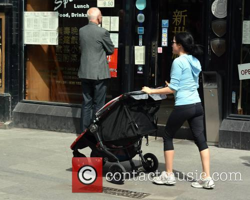 Andrea Corr spotted pushing her children in buggy