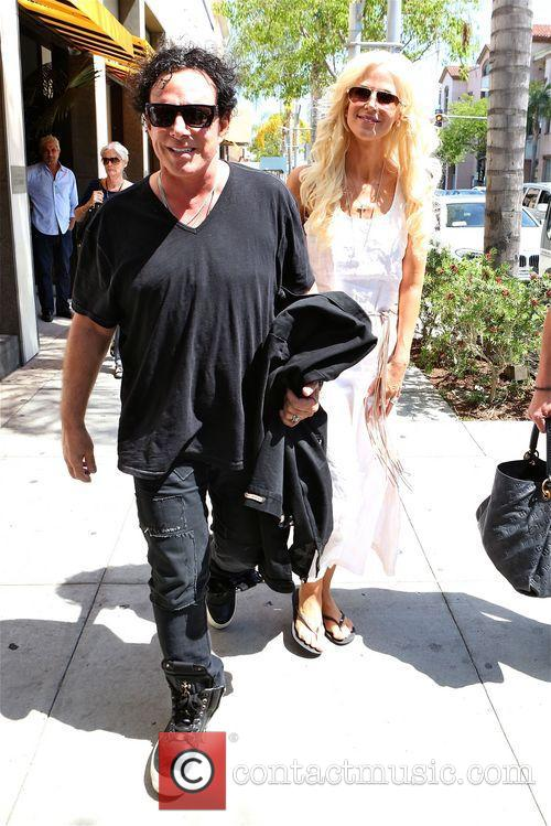 Neal Schon and Michaele Salahi out in Beverly...