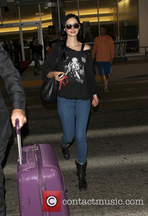 Krysten Ritter arriving at Los Angeles International (LAX)...