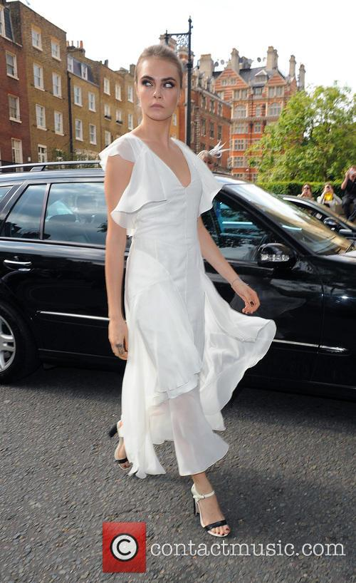 Cara Delevingne arriving at the wedding of her...