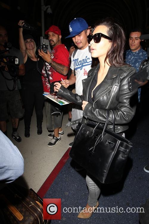 Kim Kardashian arrive at LAX on a New...