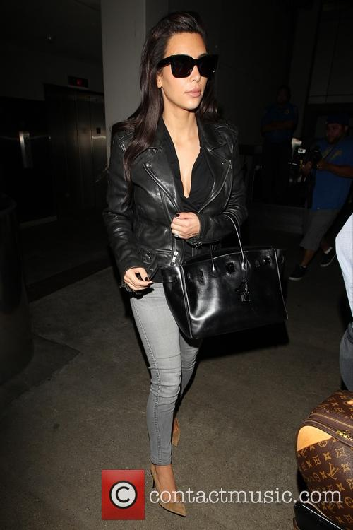 Kim Kardashian arrive at LAX on a New...