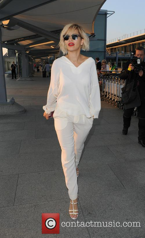 Rita Ora arrives at Heathrow Airport after a...