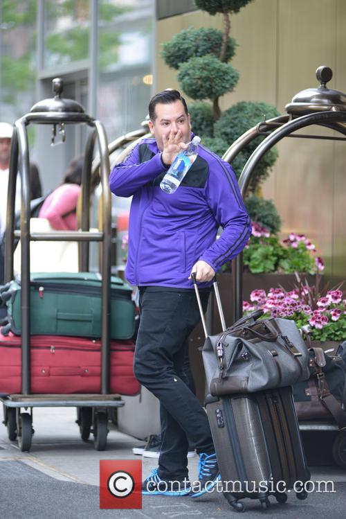 Ross Mathews exiting his hotel