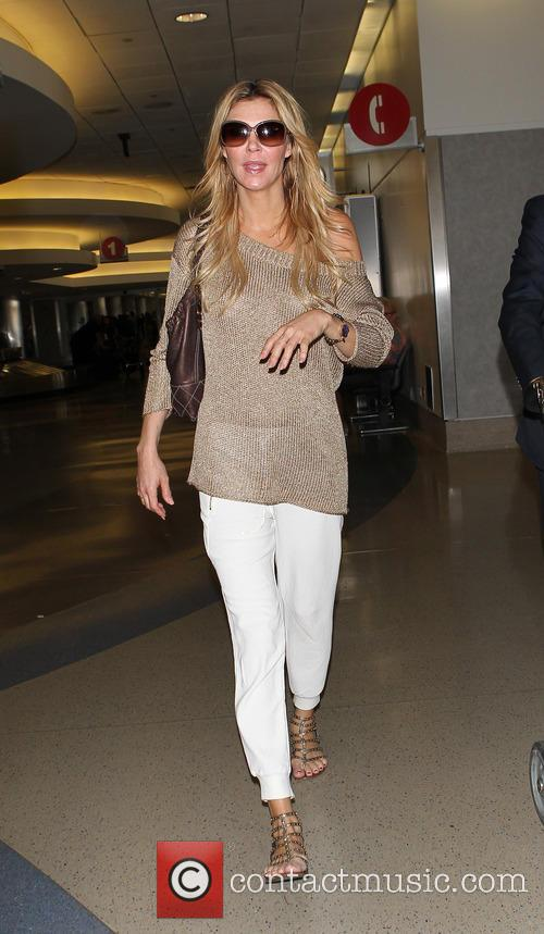 Brandi Glanville arrives at Los Angeles International (LAX)...