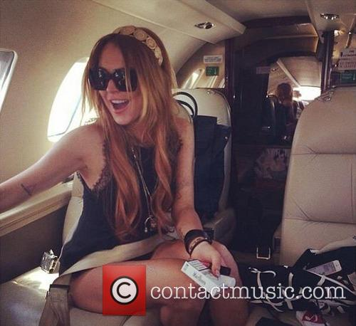Lindsay Lohan on a private Uber Jet from...