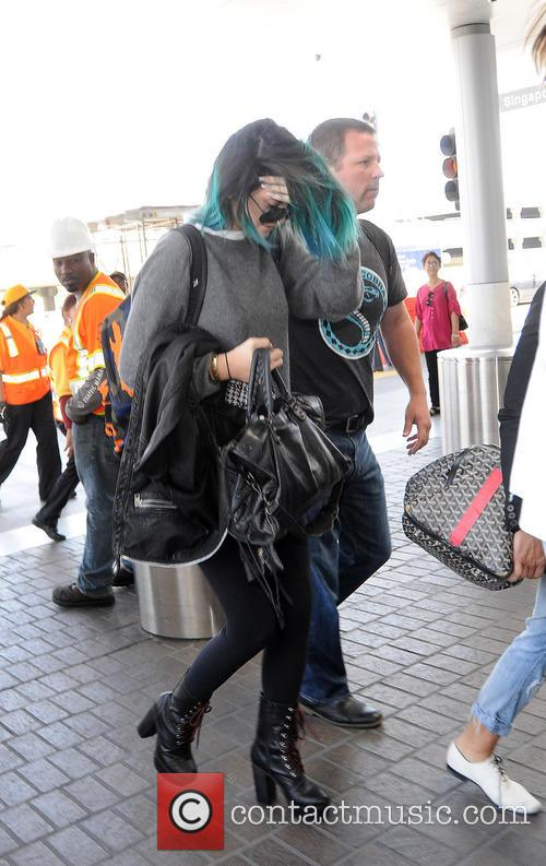 Kendall and Kylie Jenner arrive at LAX