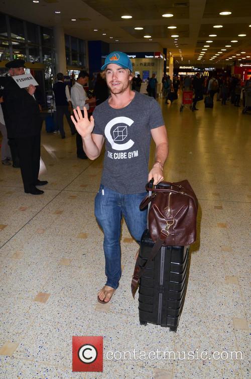 Hayden Quinn arriving at Sydney Airport