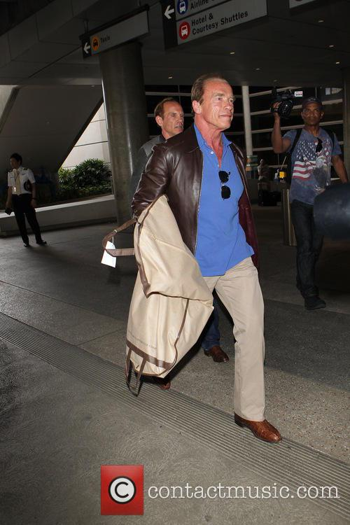Arnold Schwarzenegger arrives at Los Angeles International (LAX)...