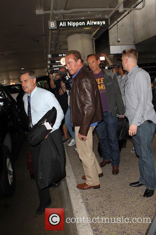 Arnold Schwarzenegger arrives at Los Angeles International (LAX) Airport