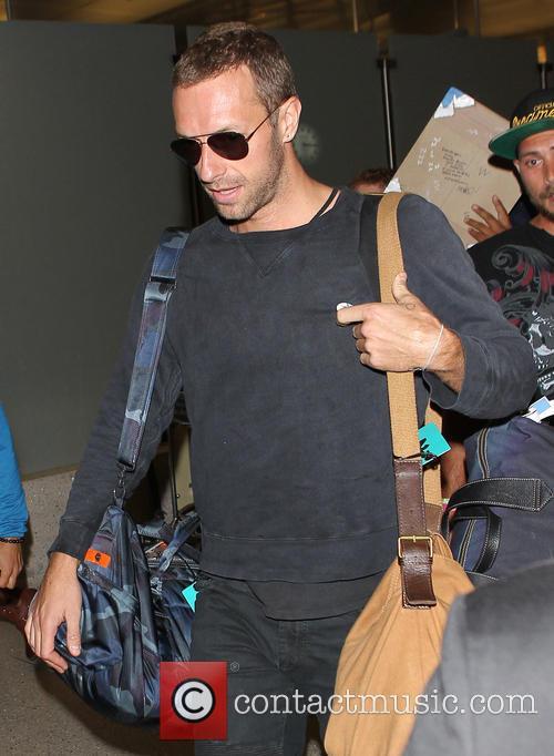 Chris Martin arrives at Los Angeles International (LAX)...