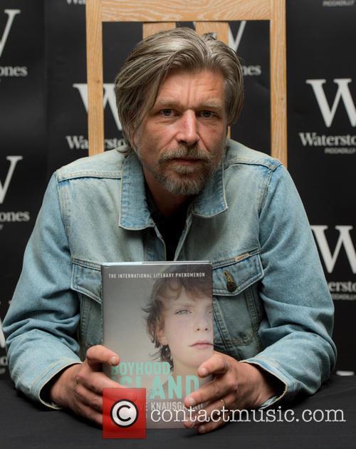 Karl Ove Knausgaard signs copies of his book...