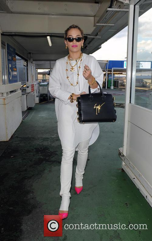 Rita Ora arrives at London Heathrow Airport with...