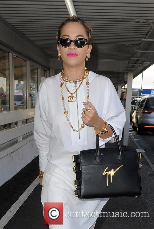 Rita Ora arrives at London Heathrow Airport with her hair in braids