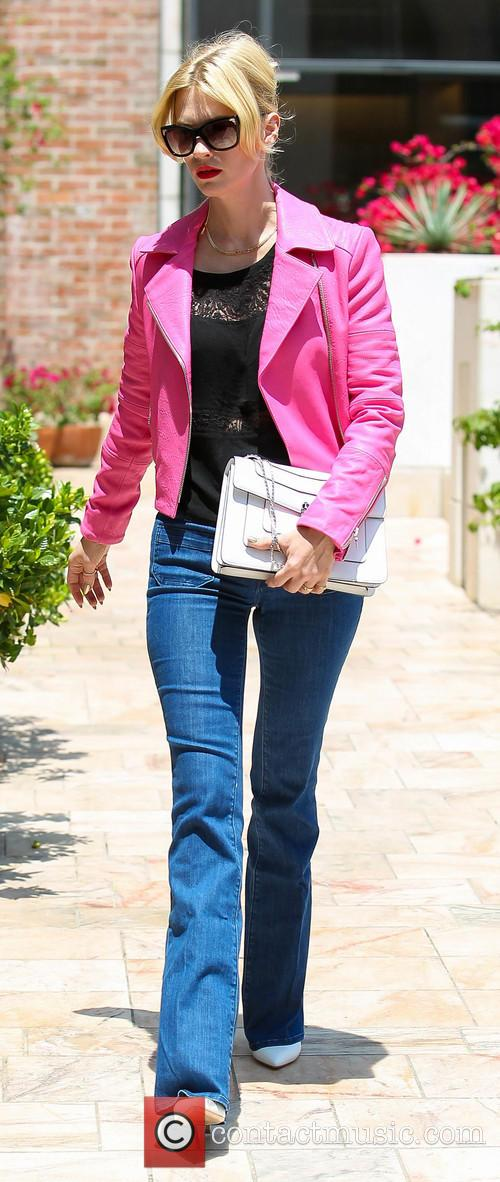 January Jones wears a hot pink jacket out in Beverly Hills