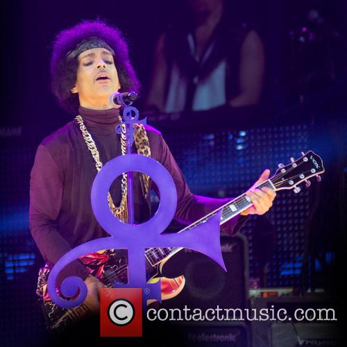 Prince performing in 2014