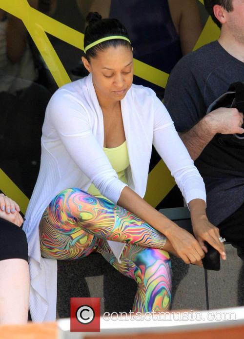 Tia Mowry visits a gym