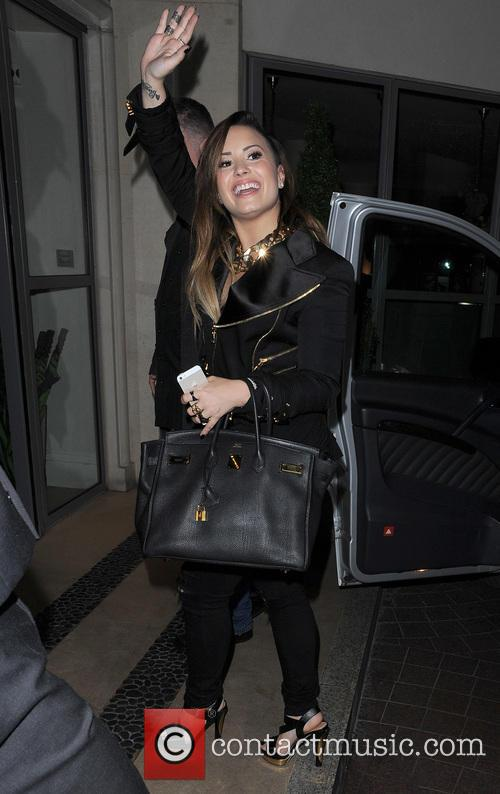 Demi Lovato is all smiles as she waves...