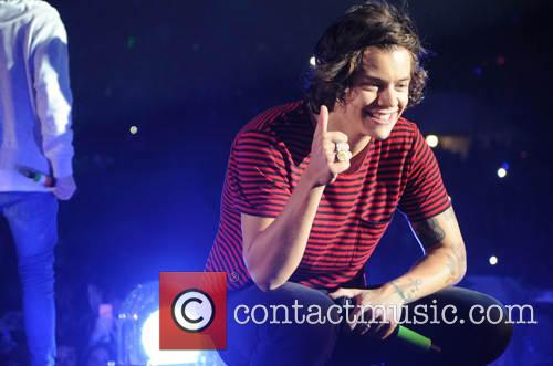 Harry Styles of One Direction performs in Edinburgh
