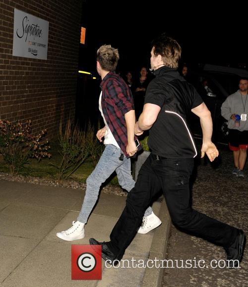 One Direction arrive at Edinburgh Airport following their...