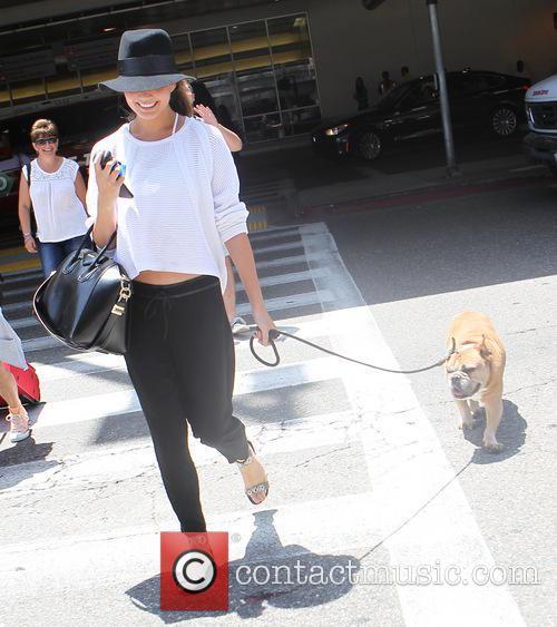 Chrissy Teigen arrives at Los Angeles International (LAX)...