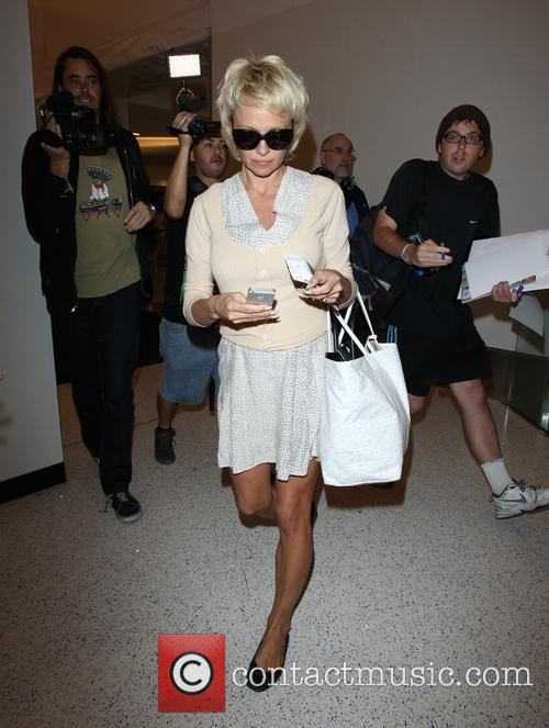 Pamela Anderson arrives at Los Angeles International (LAX) airport