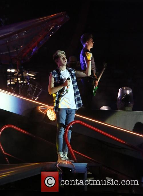 One Direction perform live