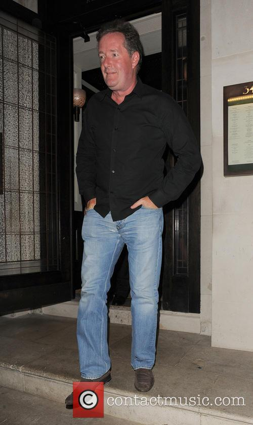 Simon Cowell and Lauren Silverman leaving 34 restaurant,...