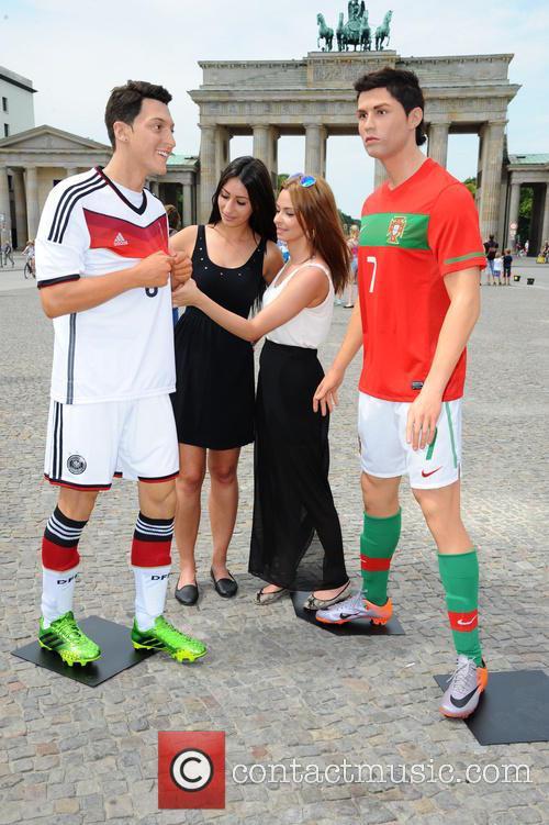Mesut Oezil and Cristiano Ronaldo 7