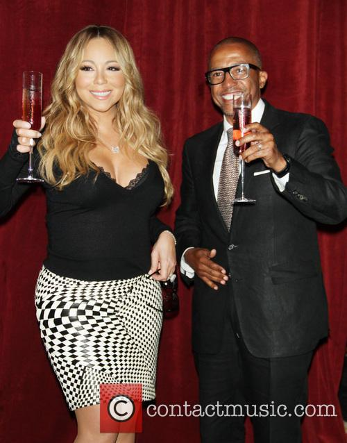 Mariah Carey and creative director Kevin Liles 12