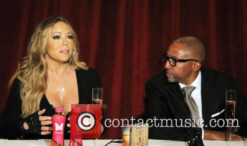 Mariah Carey and creative director Kevin Liles 13