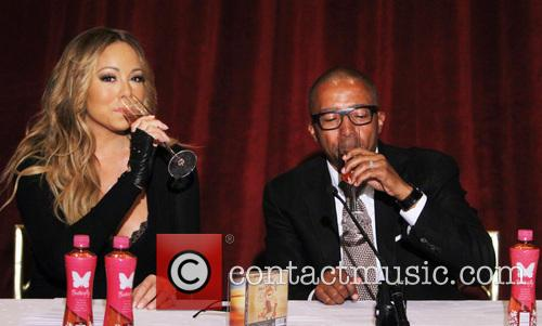 Mariah Carey and creative director Kevin Liles 14
