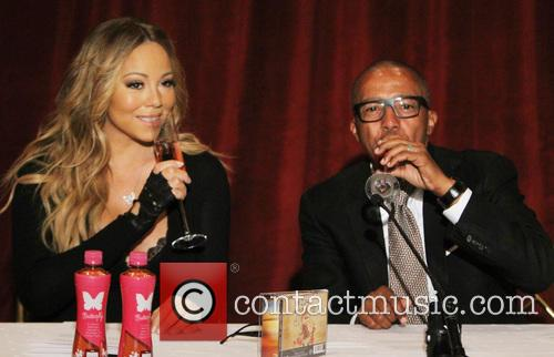 Mariah Carey and creative director Kevin Liles 16