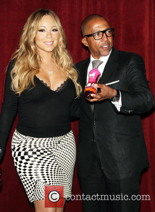 Mariah Carey and creative director Kevin Liles 17