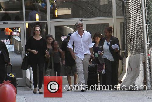 Angelina Jolie, Brad Pitt and Zahara Jolie-pitt 10