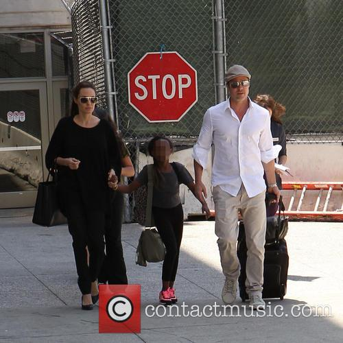 Brad Pitt and Angelina Jolie arrive at Los...