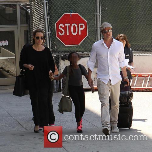 Angelina Jolie, Brad Pitt and Zahara Jolie-Pitt 14