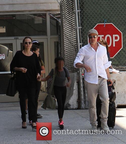Angelina Jolie, Brad Pitt and Zahara Jolie-Pitt 18