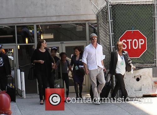 Angelina Jolie, Brad Pitt, Zahara Jolie-pitt and Maddox Jolie-pitt 8