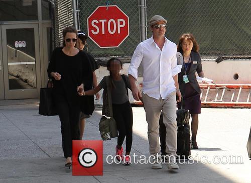 Angelina Jolie, Brad Pitt, Zahara Jolie-Pitt and Maddox Jolie-Pitt 5