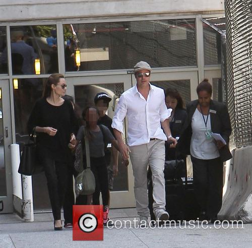 Angelina Jolie, Brad Pitt, Zahara Jolie-Pitt and Maddox Jolie-Pitt 6
