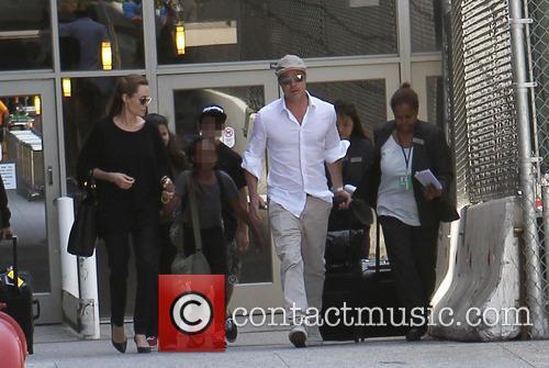 Angelina Jolie, Brad Pitt, Zahara Jolie-Pitt and Maddox Jolie-Pitt 7