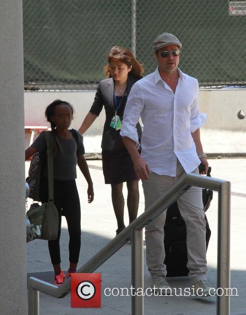 Brad Pitt and Zahara Jolie-pitt 3