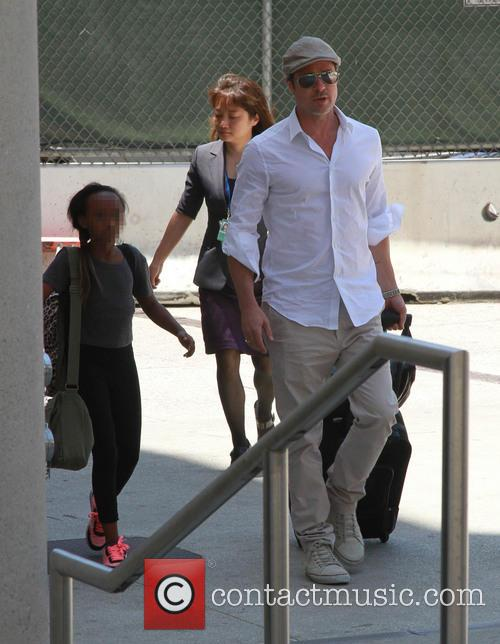 Brad Pitt and Angelina Jolie arrive at Los...