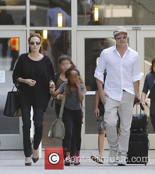Angelina Jolie, Brad Pitt and Zahara Jolie-pitt 6